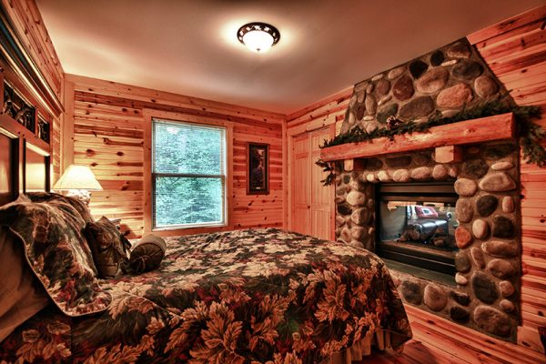 Cherry Ridge of Hocking Hills deluxe Cottages fireplace bedroom