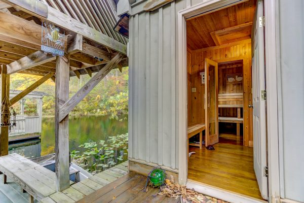 The Boat House Luxury Romantic Cabin in Hocking Hills sauna on lakeside dock
