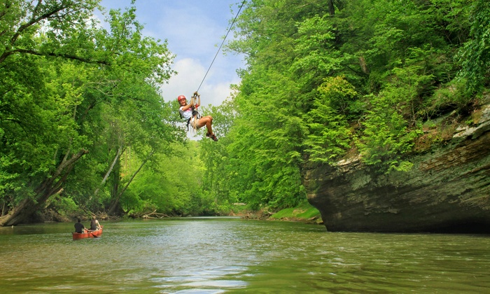 woman ziplining over the Hocking River