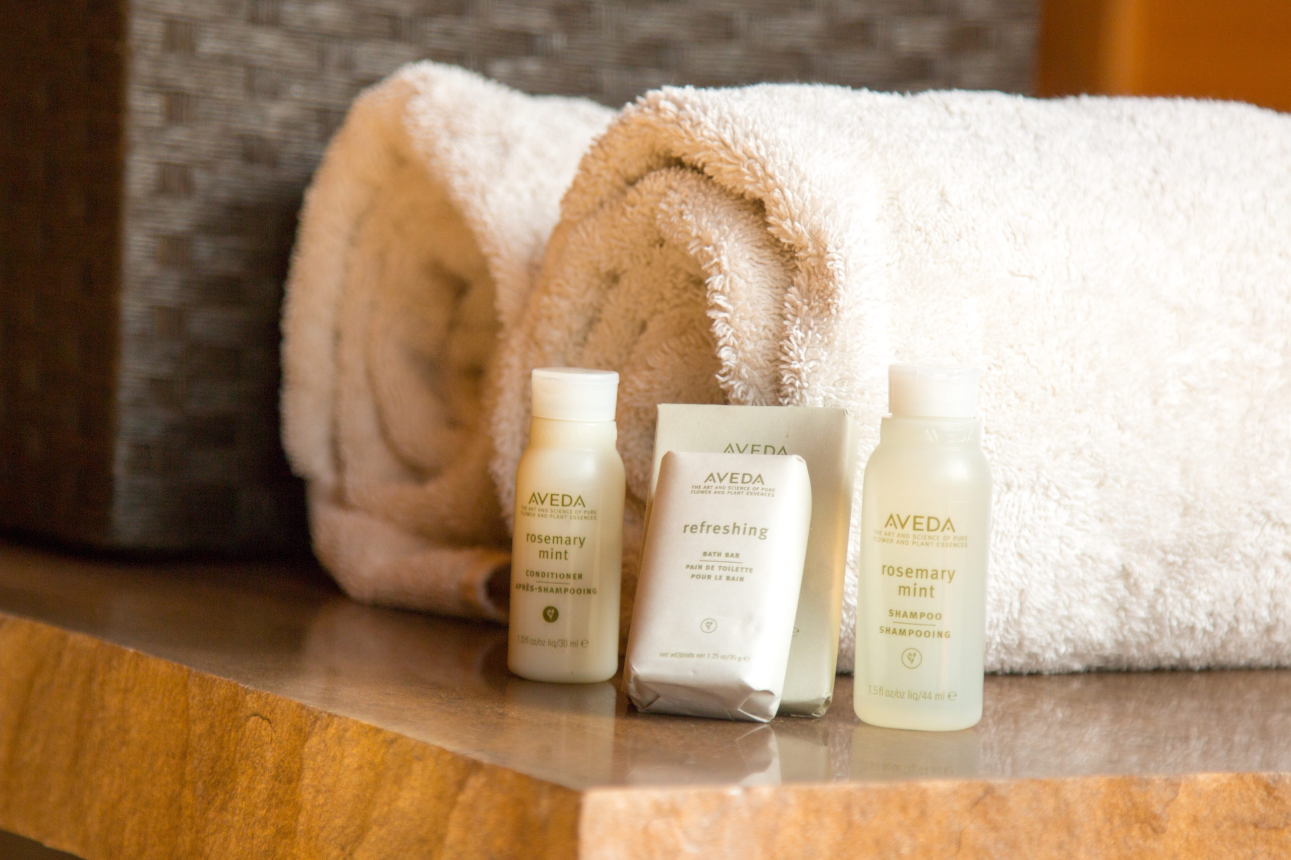 Rolled towels, Aveda bath products