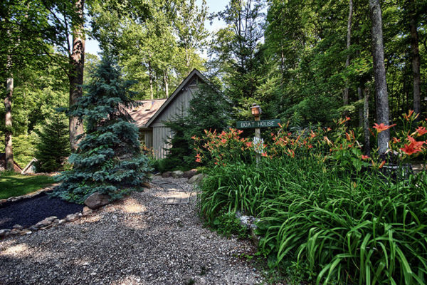 Flowers and beautiful landscaping, exterior of Boat House Cabin