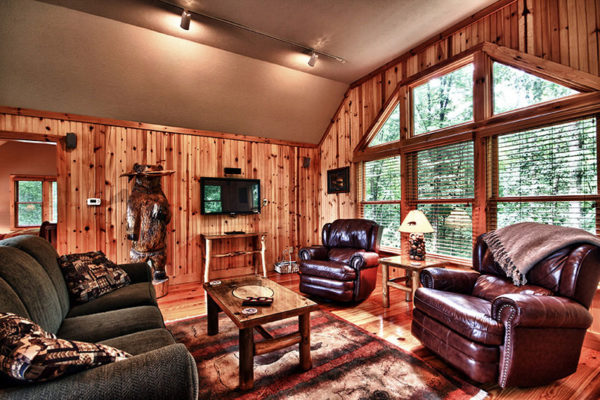 Wooden cabin interior living room. windows to private views