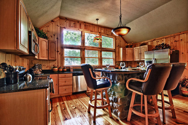 Wooden cabin interior kitchen with island