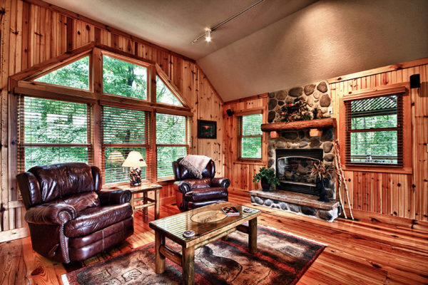 Wooden cabin interior, with stone fireplace