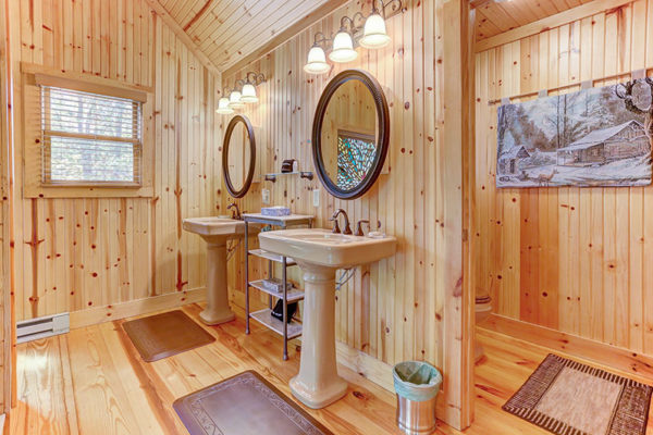 His and Hers bathroon sinks, wooden cabin interior