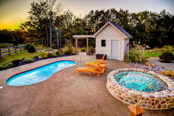 Private romantic pool and cold plunge with 2 lounge chairs, with scenic summer views