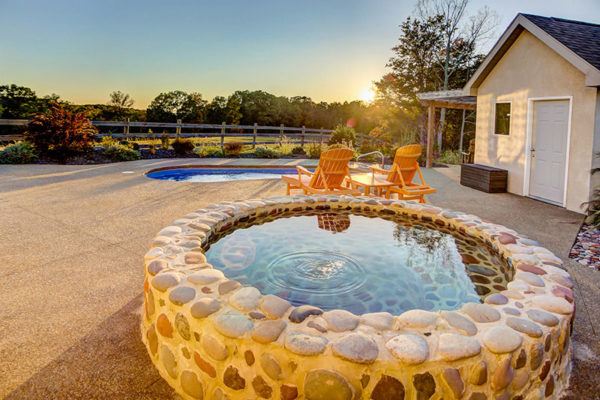 The Observatory Romantic Luxury cabin's Pool and Cold Plunge with sunset and views.