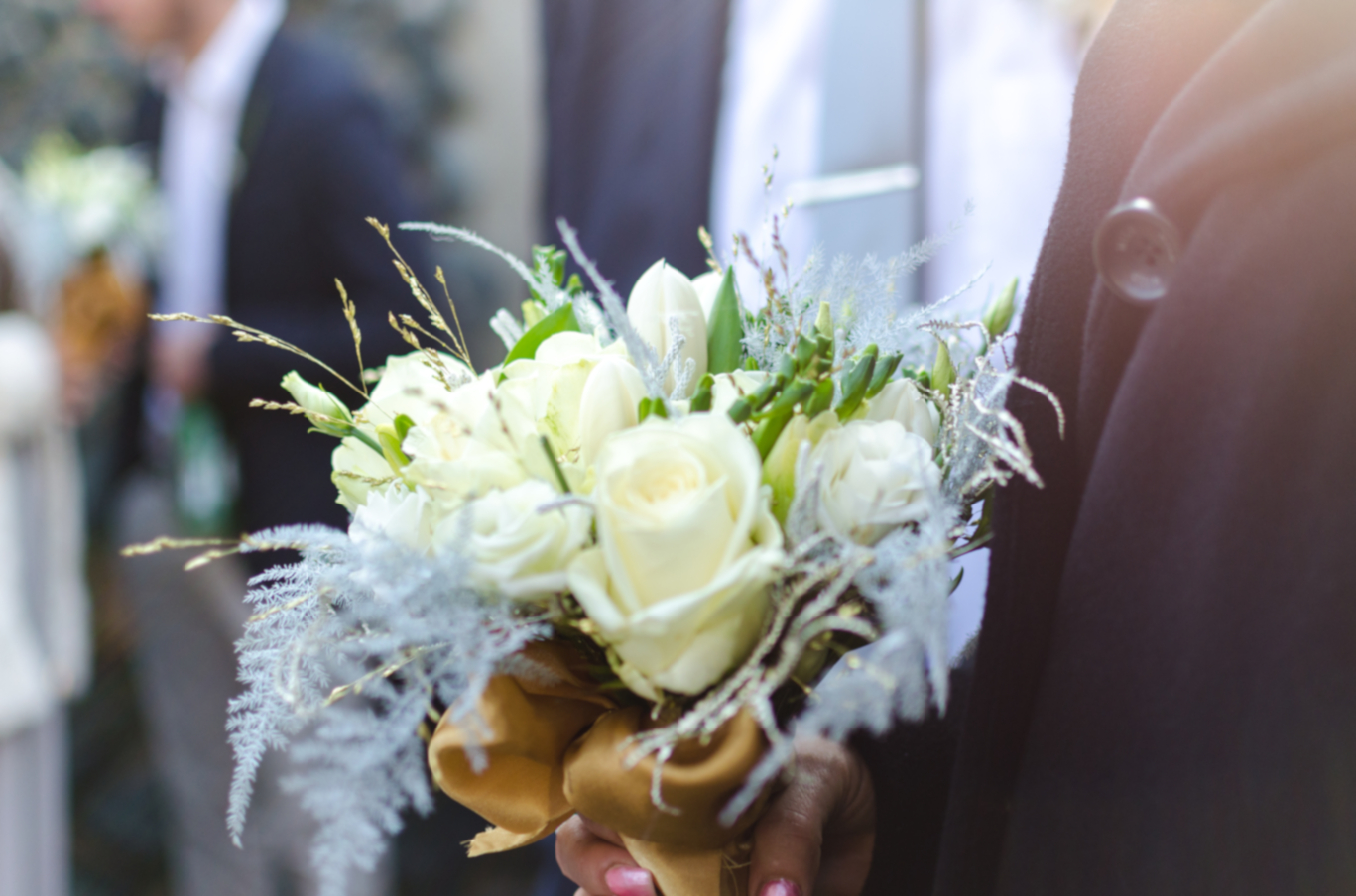 bouquet of flowers, held by hand in formal wear